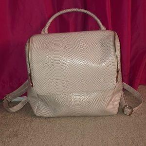 Nila Anthony blush reptile skin backpack
